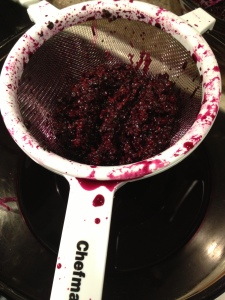Straining the elderberries